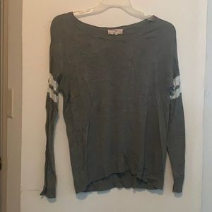 Grey long sleeve with two white stripes on sleeves